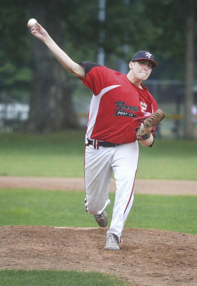 Hour photo/Alex von KleydorffNorwalk starter Sean Butler delivers a pitch during Friday's game.
