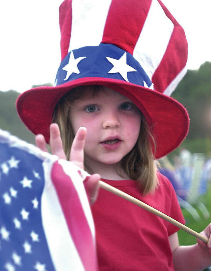 Hannah Taylor, 4, attends the annual Fourth of July fireworks celebration at Wilton High School in this file photo.