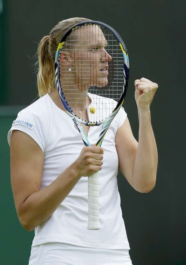 Kaia Kanepi of Estonia reacts as she defeats Angelique Kerber of Germany in a Women's second round singles match at the All England Lawn Tennis Championships in Wimbledon, London, Friday, June 28, 2013. (AP Photo/Alastair Grant)