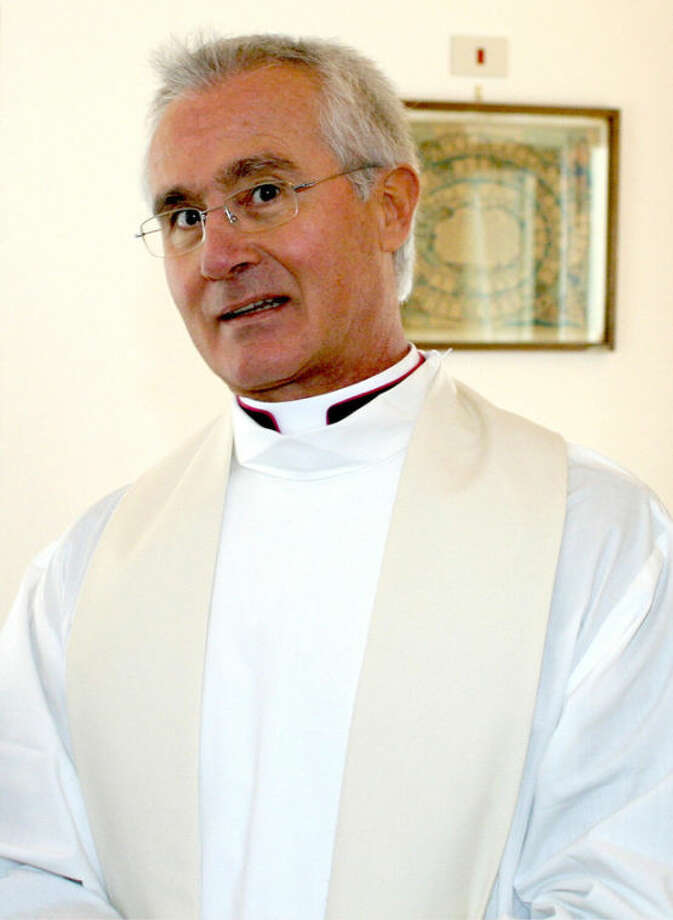 An undated photo of Monsignor Nunzio Scarano in Salerno, Italy. A Vatican official already under investigation in a purported money-laundering plot involving the Vatican bank was arrested Friday, June 28, 2013, in a separate operation: Prosecutors allege he tried to bring 20 million euros ($26 million) in cash into Italy from Switzerland aboard an Italian government plane, his lawyer said. Monsignor Nunzio Scarano, a recently suspended accountant in one of the Vatican's main financial departments, is accused of fraud, corruption and slander stemming from the plot, which never got off the ground, attorney Silverio Sica told The Associated Press. He said Scarano was a middleman in the operation: Friends had asked him to intervene with a broker, Giovanni Carenzio, to return 20 million euros they had given him to invest. Sica said Scarano persuaded Carenzio to return the money, and an Italian secret service agent, Giovanni Maria Zito, went to Switzerland to bring the cash back aboard an Italian government aircraft. Such a move would presumably prevent any reporting of the money coming into Italy. The operation failed because Carenzio reneged on the deal, Sica said. (AP Photo/Francesco Pecoraro)