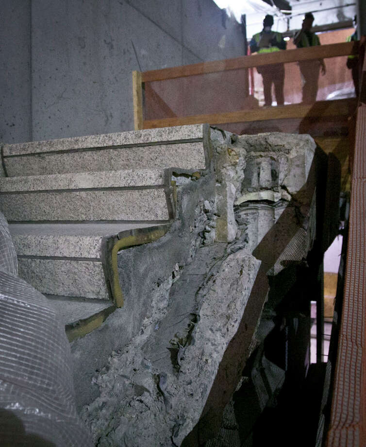 """Part of a stairway from the World Trade Center (WTC) site is shown in its permanent location at the 911 Memorial Museum on Thursday, June 27, 2013 in New York. Recovered from the WTC site after September 11, 2001, this stairway offered a clear exit from the World Trade Center Plaza to Vesey Street, providing a means of escape for hundreds fleeing from the Towers. It became symbolic of survival and acquired the name """"Survivors' Stairs."""" (AP Photo/Bebeto Matthews) / AP"""