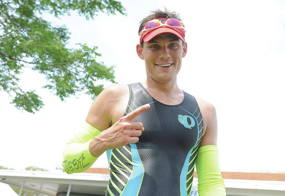 Glenn Hartrick winner of The Mighty Moss Half Iron Triathlon at Calf Pasture Beach on Sunday. Hour photo/Matthew Vinci