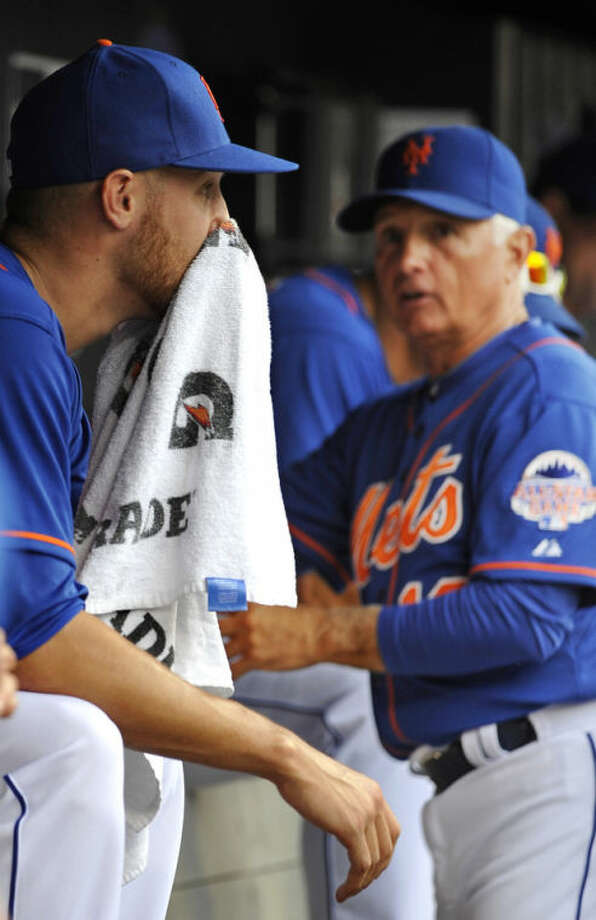 New York Mets manager Terry Collins looks over at starting pitcher Zack Wheeler in the dugout after taking Wheeler out of the baseball game against the Washington Nationals in the fifth inning at Citi Field on Sunday, June 30, 2013 in New York. (AP Photo/Kathy Kmonicek)