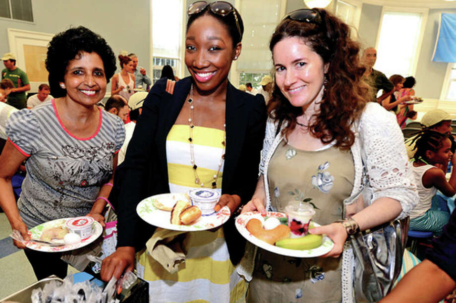 """Mary D""""Cruz, KiKi Didiju and Erin Anastasi share a bite to eat at the 48th Annual jUNe Day opening ceremonies at Saugatuck Elementary School Saturday.Hour photo / Erik Trautmann / (C)2013, The Hour Newspapers, all rights reserved"""