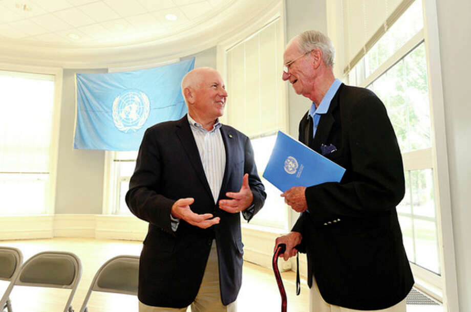 Hour photo / Erik TrautmannJim Marpie chats with Under Secretary General of the UN Ambassador Joseph Reed at the 48th Annual jUNe Day opening ceremonies at Saugatuck Elementary School Saturday. / (C)2013, The Hour Newspapers, all rights reserved