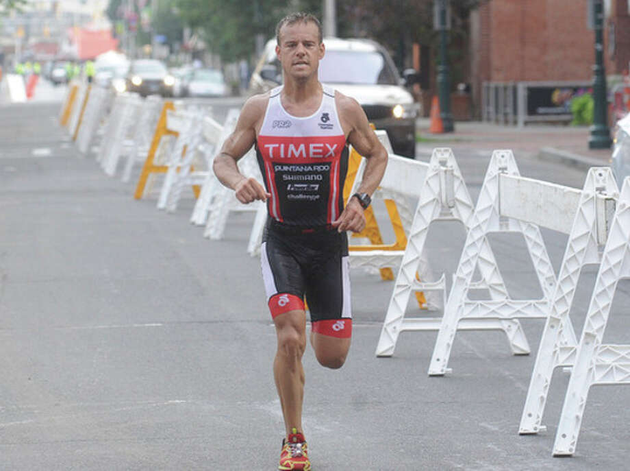 Chris Thomas of Easton wins the annual Stamford KIC-It Triathlon on Sunday. Hour photo/Matthew Vinci
