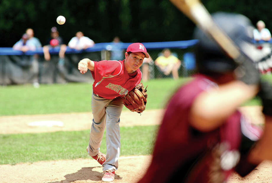 Hour photo/Erik TrautmannScott Whalen of the Norwalk Little League All-Stars throws from the mound in their District 1 Little League pool play tournament game against Stamford National at Chesnut Hill Park in Stamford Saturday. / (C)2013, The Hour Newspapers, all rights reserved