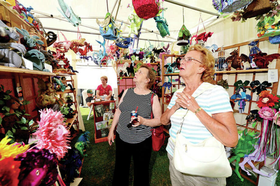 Marge Kitchens and Shirlie Kemsek look at the Fantasy Dolls by Kathy Pilipauskas during the first annual Norwalk Art Festival at Mathews Park Saturday.Hour photo / Erik Trautmann / (C)2013, The Hour Newspapers, all rights reserved
