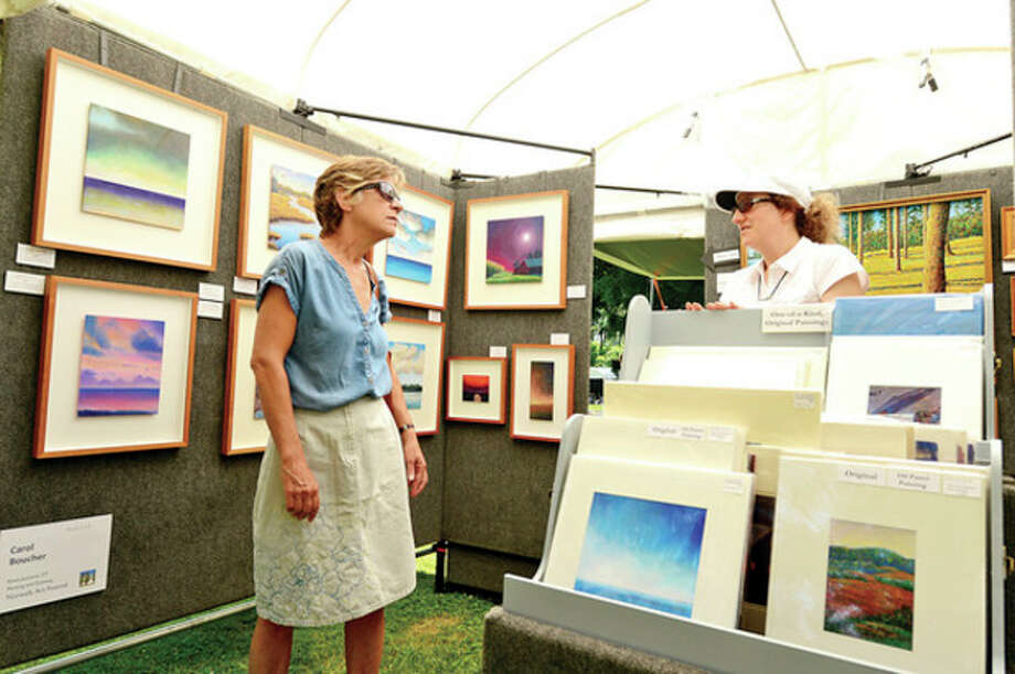 Maggie Silverstein looks at the art of Carol Boucher during the first annual Norwalk Art Festival at Mathews Park Saturday.Hour photo / Erik Trautmann / (C)2013, The Hour Newspapers, all rights reserved