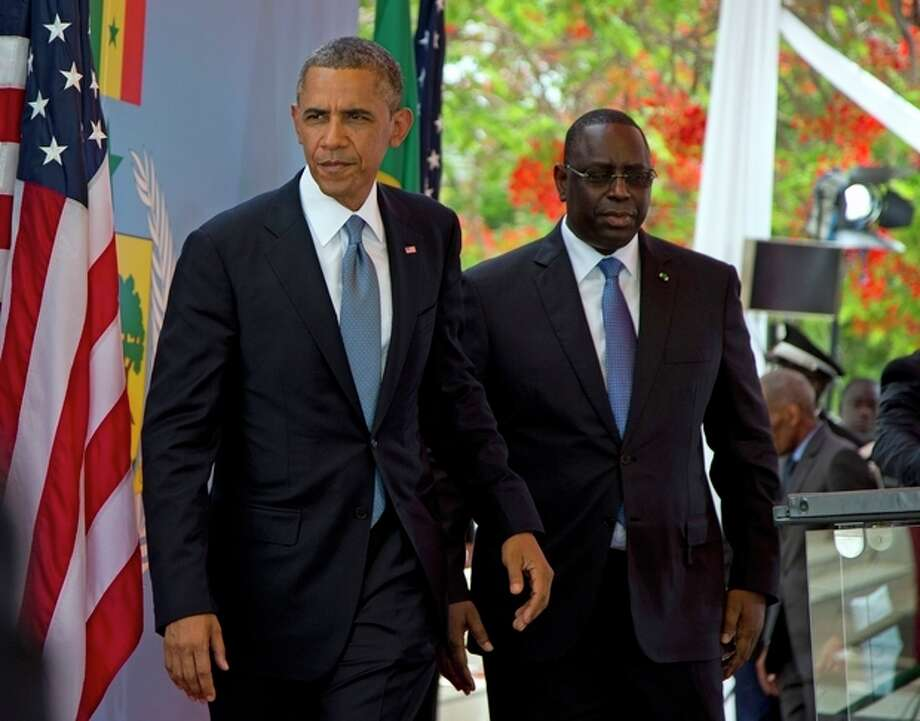 President Barack Obama and Senegalese President Macky Sall leave after a news conference at the Presidential Palace in Dakar, Senegal Thursday, June 27, 2013. Obama is visiting Senegal, South Africa, and Tanzania on a week long trip. (AP Photo/Evan Vucci) / AP