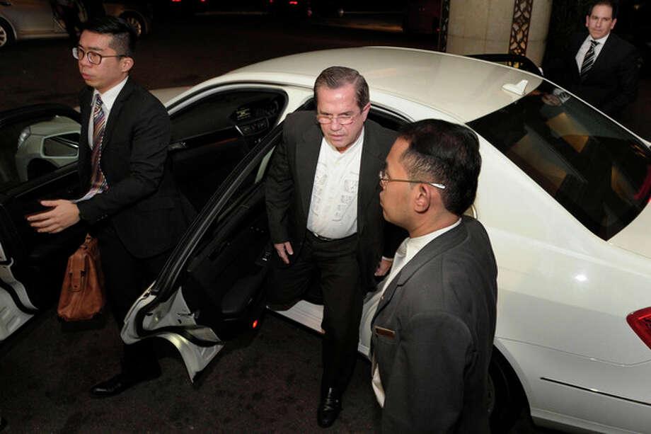 Ecuador's Foreign Minster Ricardo Patino arrives for a reception at Singapore's Shangri-la Hotel on Thursday, June 27, 2013. (AP Photo/Joseph Nair) / AP