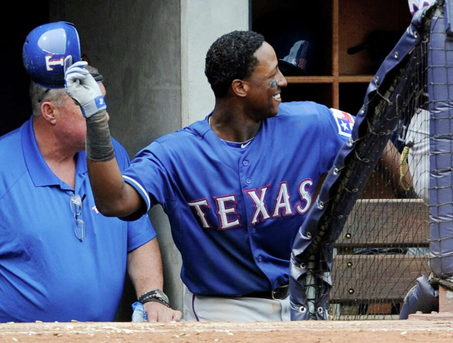 Texas Rangers' Jurickson Profar reacts as he comes back to the dugout after hitting a home run during the fifth inning of a baseball game against the New York Yankees Thursday, June 27, 2013, at Yankee Stadium in New York. (AP Photo/Bill Kostroun) / FR51951 AP