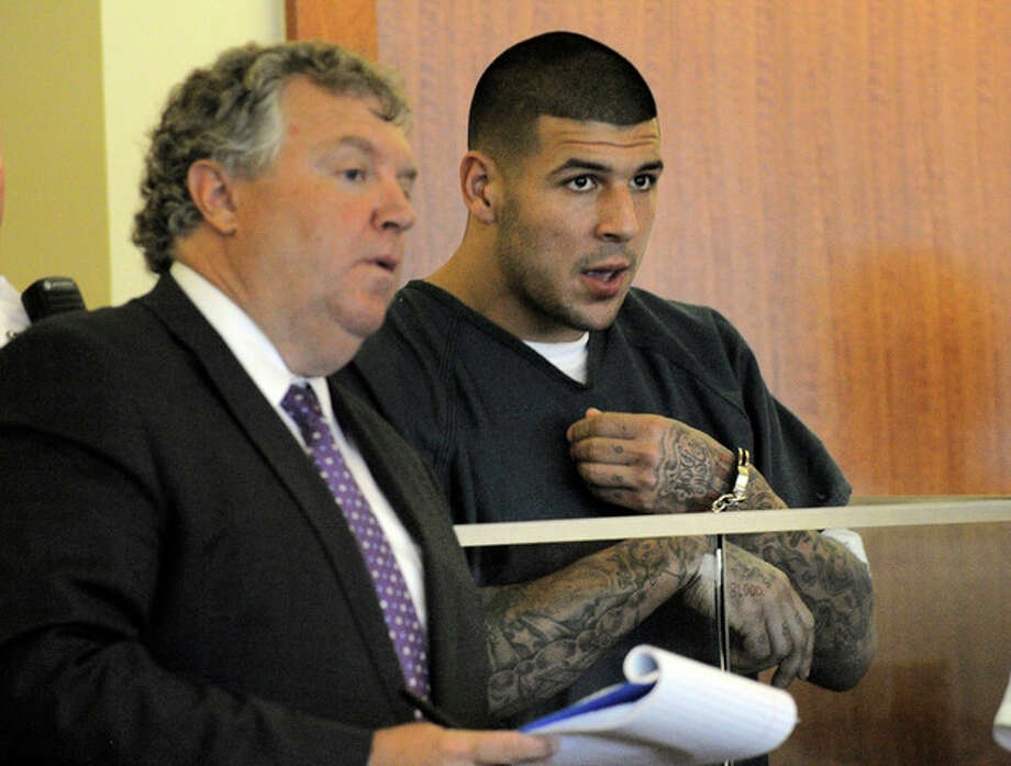 Former New England Patriots football player Aaron Hernandez, right, stands with his attorney Michael Fee, during a bail hearing in Fall River Superior Court Thursday, June 27, 2013, in Fall River, Mass. Hernandez, charged with murdering Odin Lloyd, a 27-year-old semi-pro football player, was denied bail. (AP Photo/Boston Herald, Ted Fitzgerald, Pool) / Pool, Boston Herald