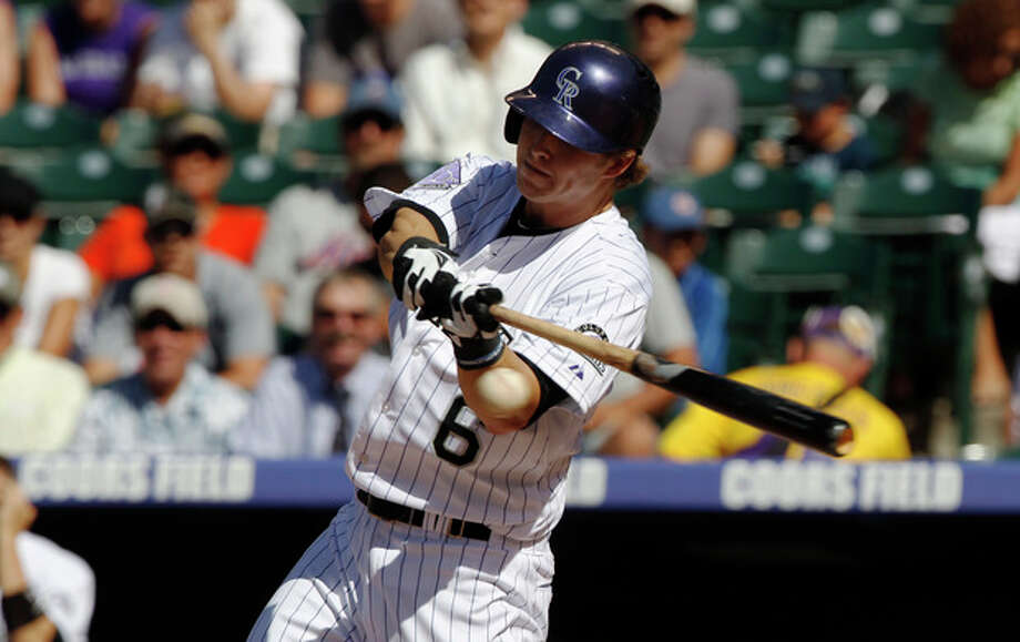 Colorado Rockies' Corey Dickerson swings at a pitch against the New York Mets in the first inning of a baseball game in Denver on Thursday, June 27, 2013. (AP Photo/David Zalubowski) / AP