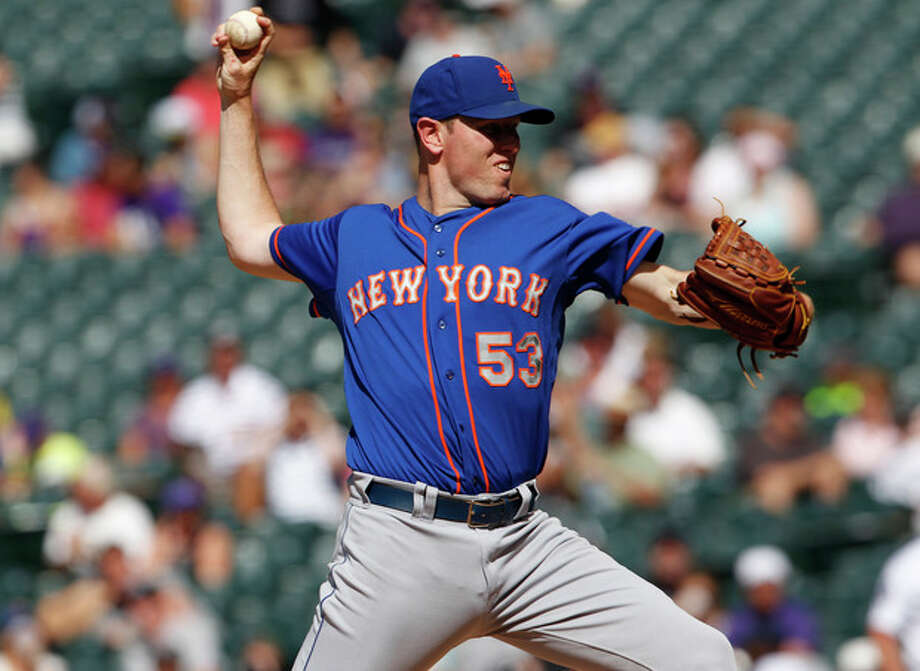 New York Mets starting pitcher Jeremy Hefner works against the Colorado Rockies in the first inning of a baseball game in Denver on Thursday, June 27, 2013. (AP Photo/David Zalubowski) / AP