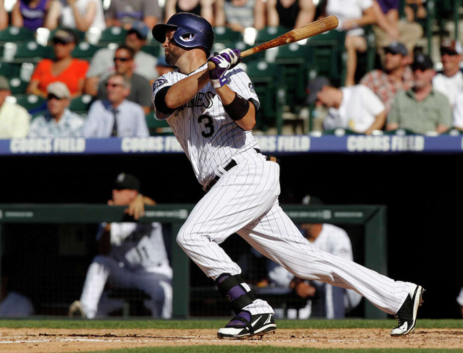 Colorado Rockies' Michael Cuddyer follows the flight of his fly out against the New York Mets in the fourth inning of a baseball game in Denver on Thursday, June 27, 2013. Cuddyer extended his career-best hitting streak to 24 games in the second inning. (AP Photo/David Zalubowski) / AP