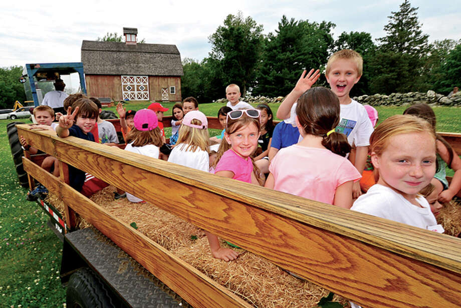 Campers enjoy a hayride as Ambler Farm begins its summer programs for preschoolers and students grades 1-7 this week through July. The programs introduce children to animals on the farm, harvesting, woodworking and planting. Hour photo / Erik Trautmann / (C)2013, The Hour Newspapers, all rights reserved