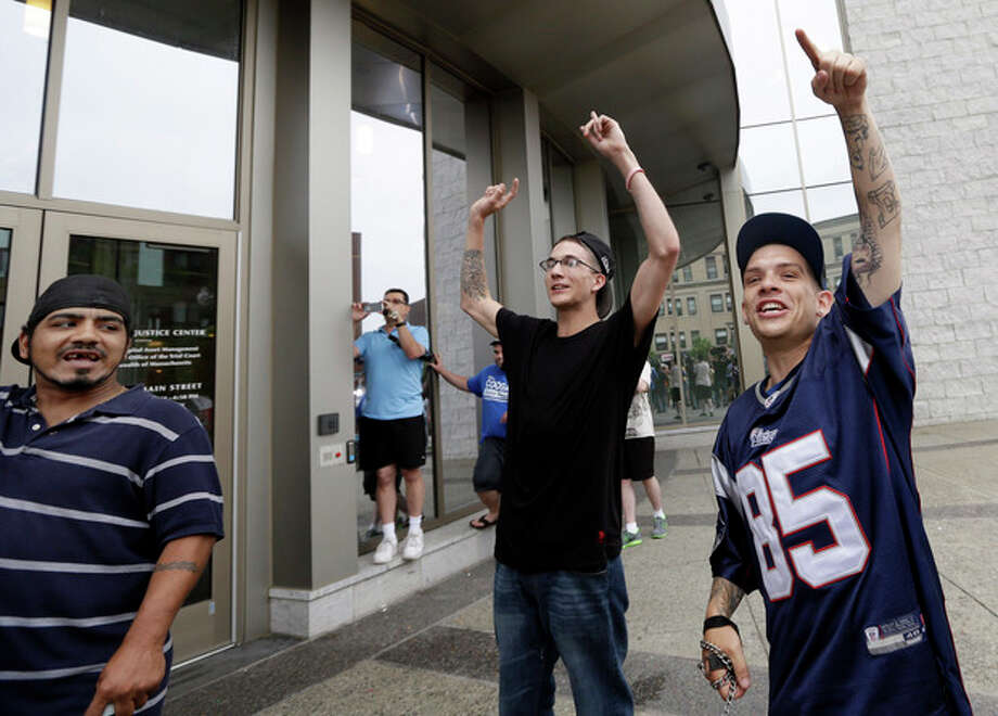 Bystanders chant and take pictures outside the entrance to the Fall River Justice Center after a bail hearing was held for former New England Patriots football player Aaron Hernandez in Fall River Superior Court Thursday, June 27, 2013 in Fall River, Mass. Hernandez, charged with murdering Odin Lloyd, a 27-year-old semi-pro football player, was denied bail. (AP Photo/Elise Amendola) / AP