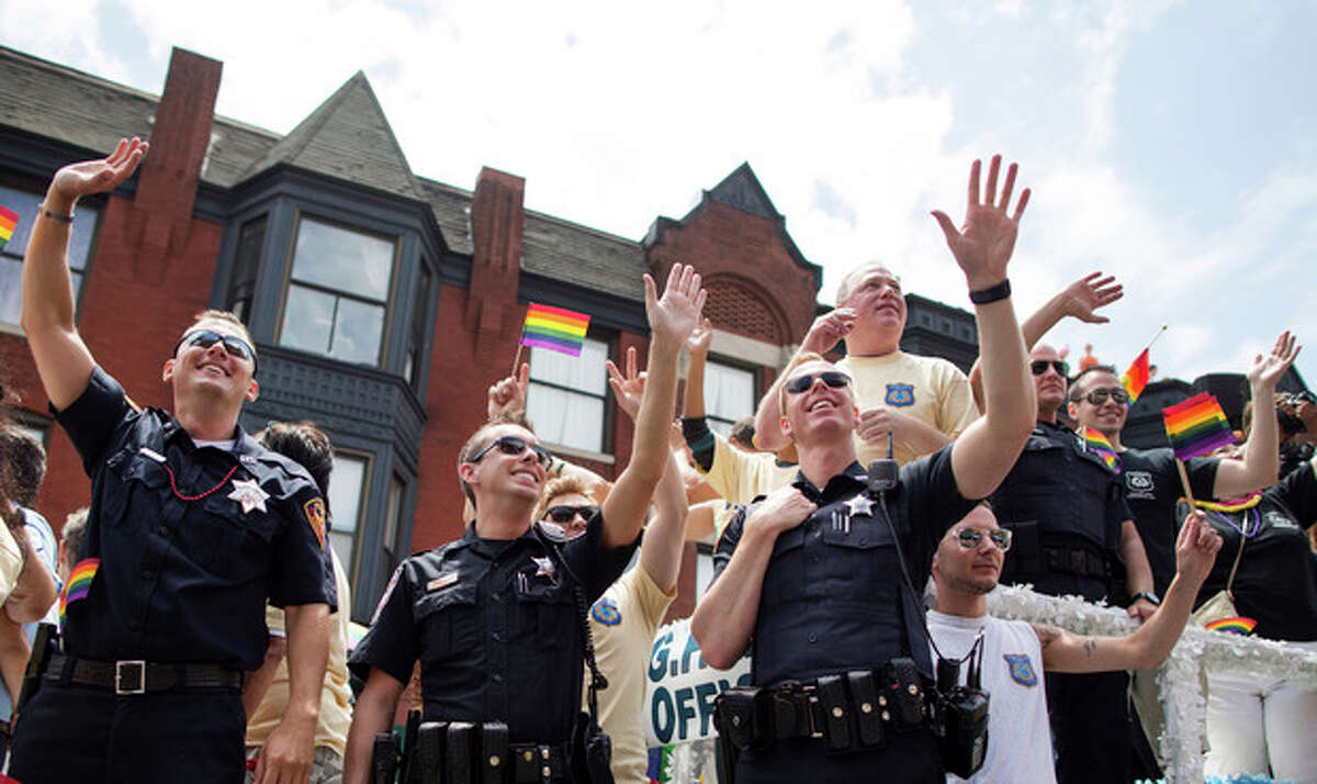 Members of the Chicago Lesbian and Gay Police Association wave to crowds during the Chicago Gay Pride Parade in Chicago, Sunday, June 30, 2013. (AP Photo/Scott Eisen)