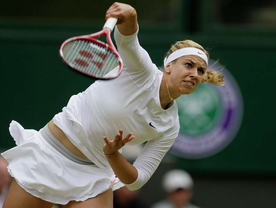 Sabine Lisicki of Germany serves to Serena Williams of the United States in a Women's singles match at the All England Lawn Tennis Championships in Wimbledon, London, Monday, July 1, 2013. (AP Photo/Alastair Grant) / AP