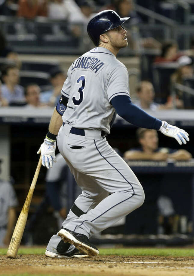 Tampa Bay Rays' Evan Longoria (3) watches a ball he hit for a home run during the eighth inning of a baseball game against the New York Yankees, Thursday, June 20, 2013, in New York. (AP Photo/Frank Franklin II)