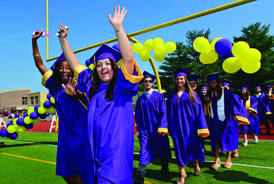 Westhill High School seniors Michelle Griffin and Hilda Calderon prepare to graduate during the class of 2013 commencement ceremonies Thursday. Hour photo / Erik Trautmann