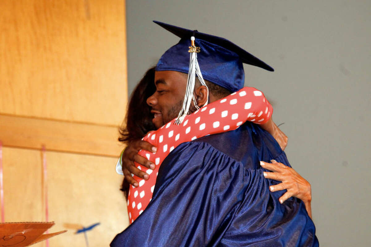 Willie Tremayne June hugs Angela Tudisco during Briggs High School's commencement ceremony held at Brien McMahon in Norwalk Thursday evening. Hour Photo / Danielle Calloway