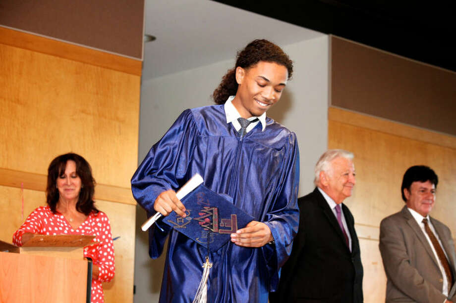 Khalil Jamal Bailey smiles after receiving his diploma during Briggs High School's commencement ceremony held at Brien McMahon in Norwalk Thursday evening. Hour Photo / Danielle Calloway