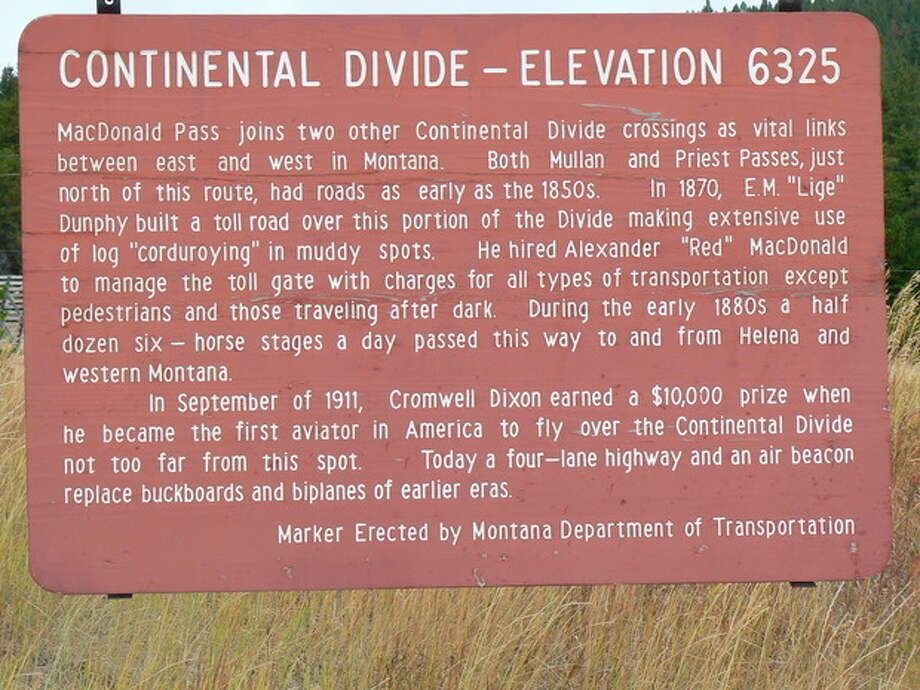 This undated photo provided by the Helena Convention and Visitors Bureau shows the sign for the Continental Divide near MacDonald Pass, which offers more than 10 miles of trails in the backcountry of the divide just 15 miles west of Helena, Mont. The area attracts cross-country skiers in winter but can be hiked in other seasons. It's one of a number of free things to see and do in the Helena area, which is about halfway between Glacier and Yellowstone national parks. (AP Photo/Mike Mergenthaler) / Helena CVB