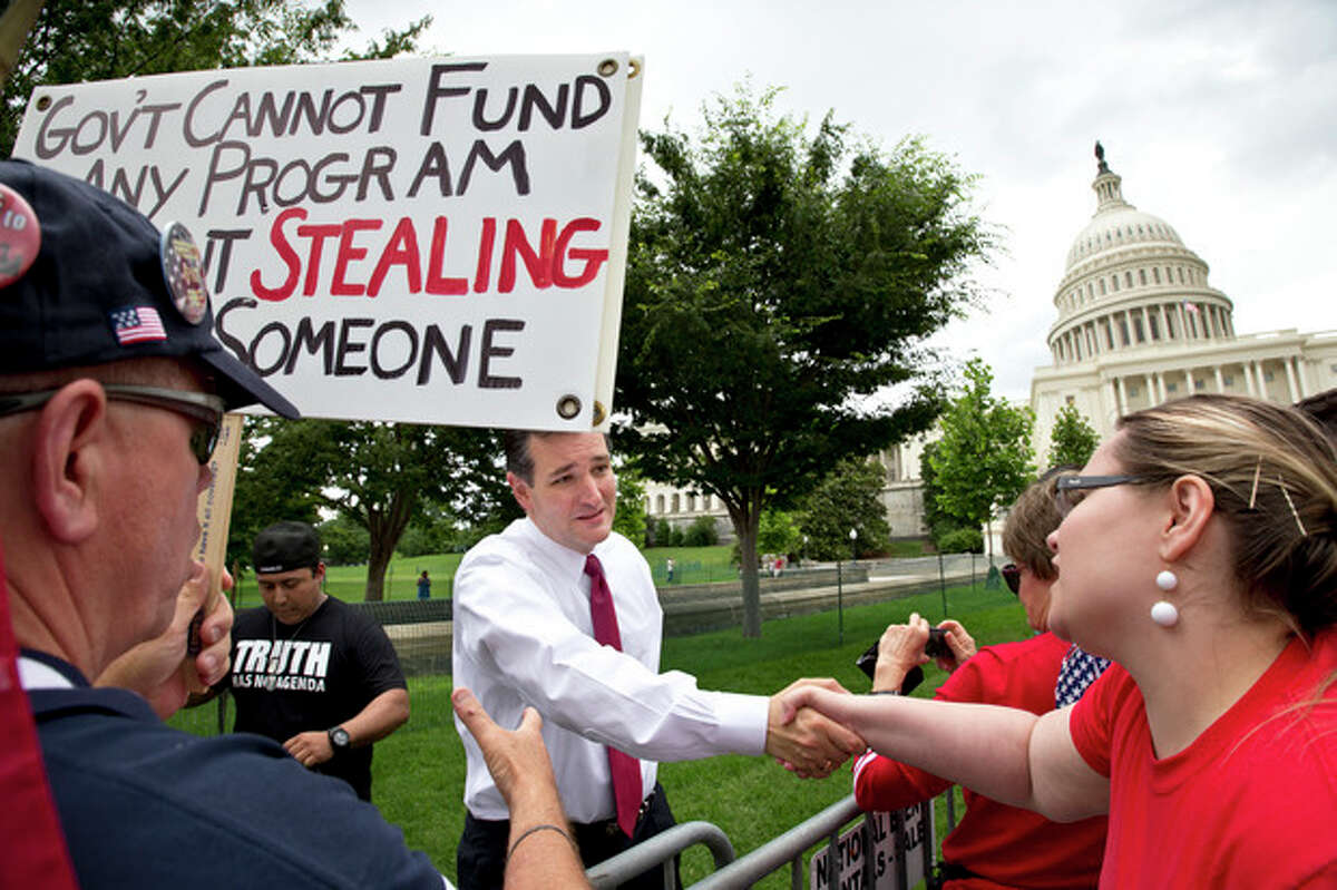 AP Photo/J. Scott Applewhite In this June 19, photo, Sen. Ted Cruz, R-Texas, greets supporters after addressing thousands of tea party activists at the U.S. Capitol railing against the Internal Revenue Service, illegal immigration, and the Obama administration, in Washington.