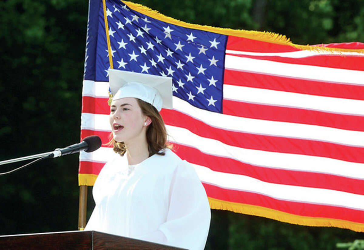 Hour photo / Erik Trautmann Valedictorian Paige Wallce addresses the Wilton High School Class of 2013 during their commencement exercises Saturday evening.