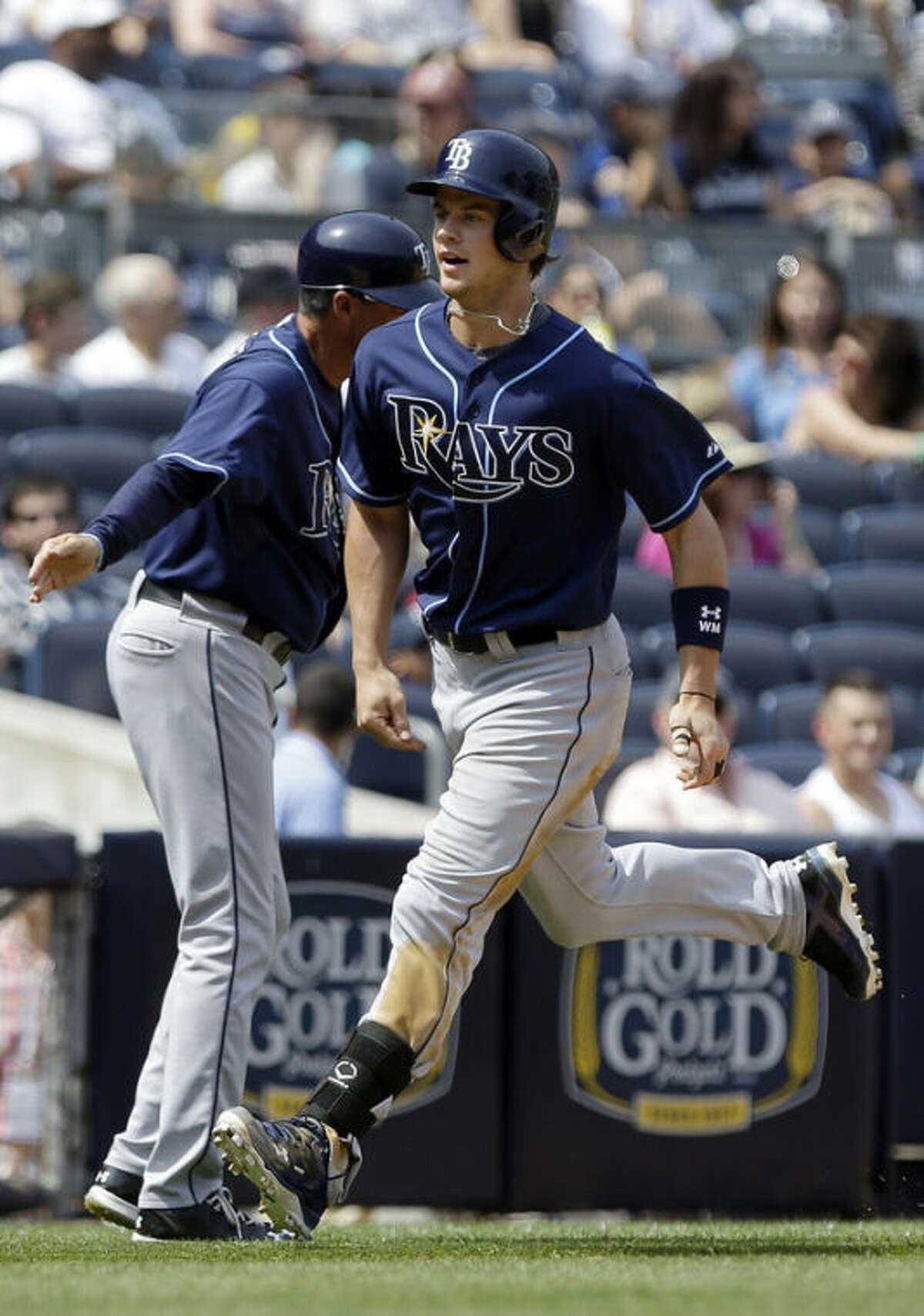 Tampa Bay Rays' Wil Myers heads to home plate after hitting a grand slam during the sixth inning of a baseball game Saturday, June 22, 2013, in New York. (AP Photo/Frank Franklin II)