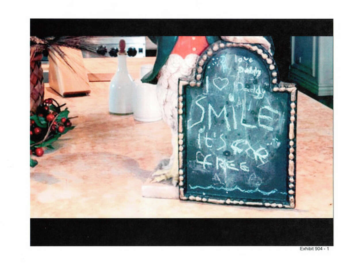 In this undated photo released by the LA Superior Court and presented as evidence, a 2009 message written by Paris Jackson about her father, Michael Jackson, is seen on a chalkboard that was placed in the kitchen of the singer?'s rented mansion in Los Angeles. The message remained on the board on the day Jackson died in June 2009, and was described to a jury hearing a case in Los Angeles filed by Jackson?'s mother by the singer?'s chef, Kai Chase, during testimony on Tuesday, June 18, 2013. (AP Photo/LA Superior Court)