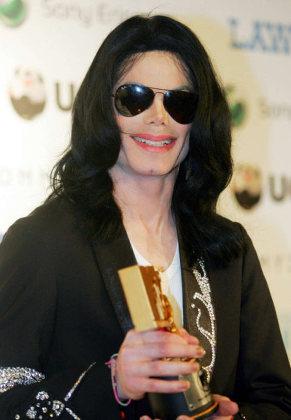 FILE - In this May 27, 2006 file photo, Michael Jackson smiles during a press conference of the MTV Video Music Awards Japan 2006 in Tokyo. The U.S. entertainer was awarded a Legend Award at the ceremony. Jurors hearing a civil case in Los Angeles filed by Jackson?'s mother, Katherine Jackson, have heard numerous stories about the entertainer?'s devotion to his children as expressed through extravagant birthday parties and secret family outings. The tender moments have been described throughout the trial, which concluded its eighth week on Friday, June 21, 2013. (AP Photo/Koji Sasahara, File)