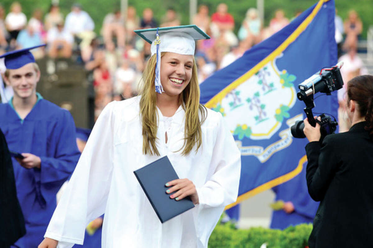 Lydia Freliech receives her diploma during the Wilton High School Class of 2013 commencement exercises Saturday evening. Hour photo / Erik Trautmann