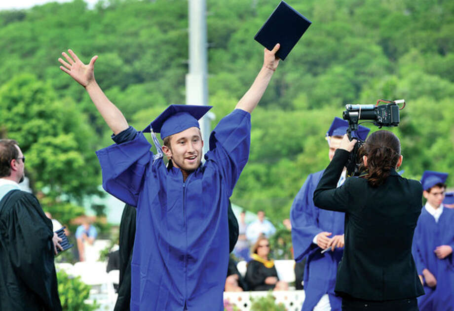 Hour photo / Erik TrautmannRoberto Aravena celebrates after receiving his diploma during the Wilton High School Class of 2013 commencement exercises Saturday evening. / (C)2013, The Hour Newspapers, all rights reserved