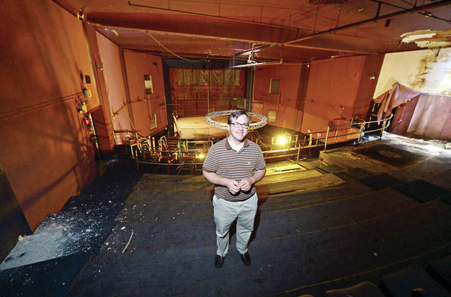 Frank Farricker, prospective buyer and developer of the former Globe Theater on Wall Street, tours inside the historic building at 71 Wall St.Hour photo / Erik Trautmann / (C)2013, The Hour Newspapers, all rights reserved