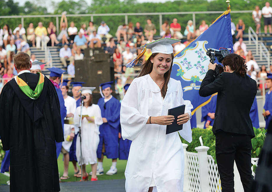 Graduates celebrate during the Wilton High School Class of 2013 commencement exercises Saturday evening. Hour photo / Erik Trautmann / ©2013 The Hour Newspapers