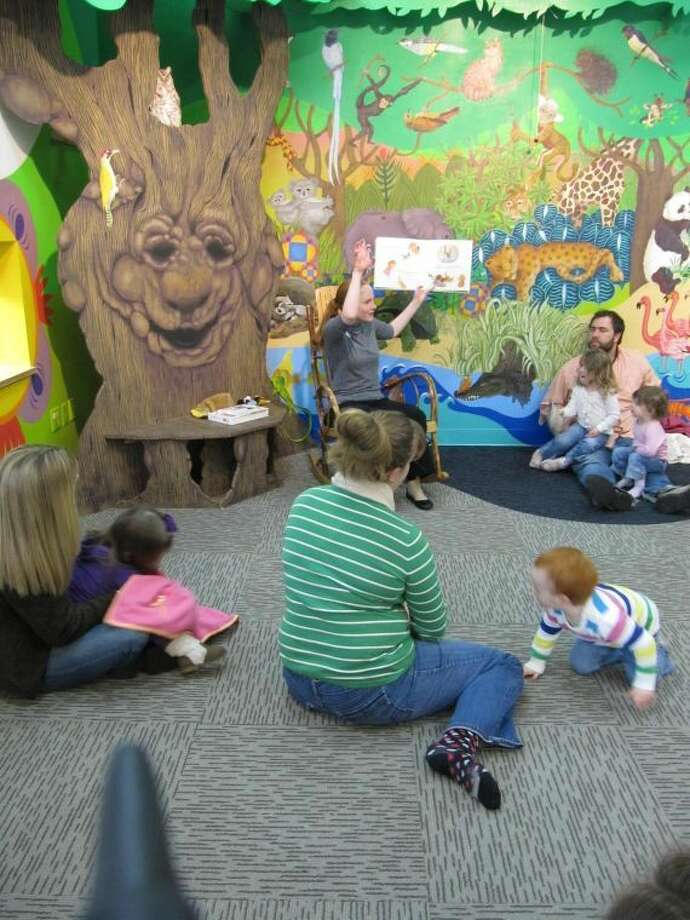 Children and parents enjoy story times as the Wilton Library's summer reading program with activities for toddlers to teens.