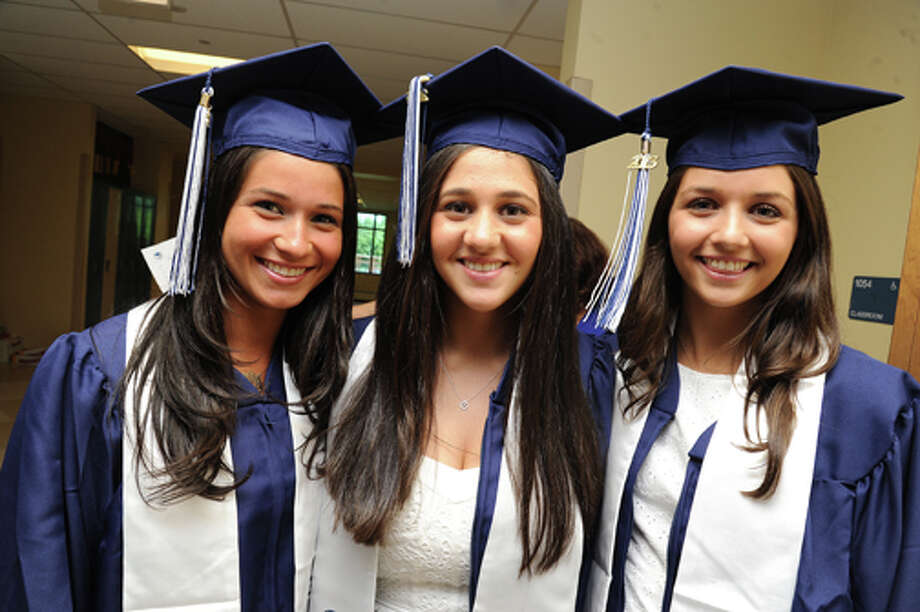 Katie Glick, Zoe Cohen and Izzy Claverloux at the Staples High School graduation on Friday. Hour photo/Matthew Vinci