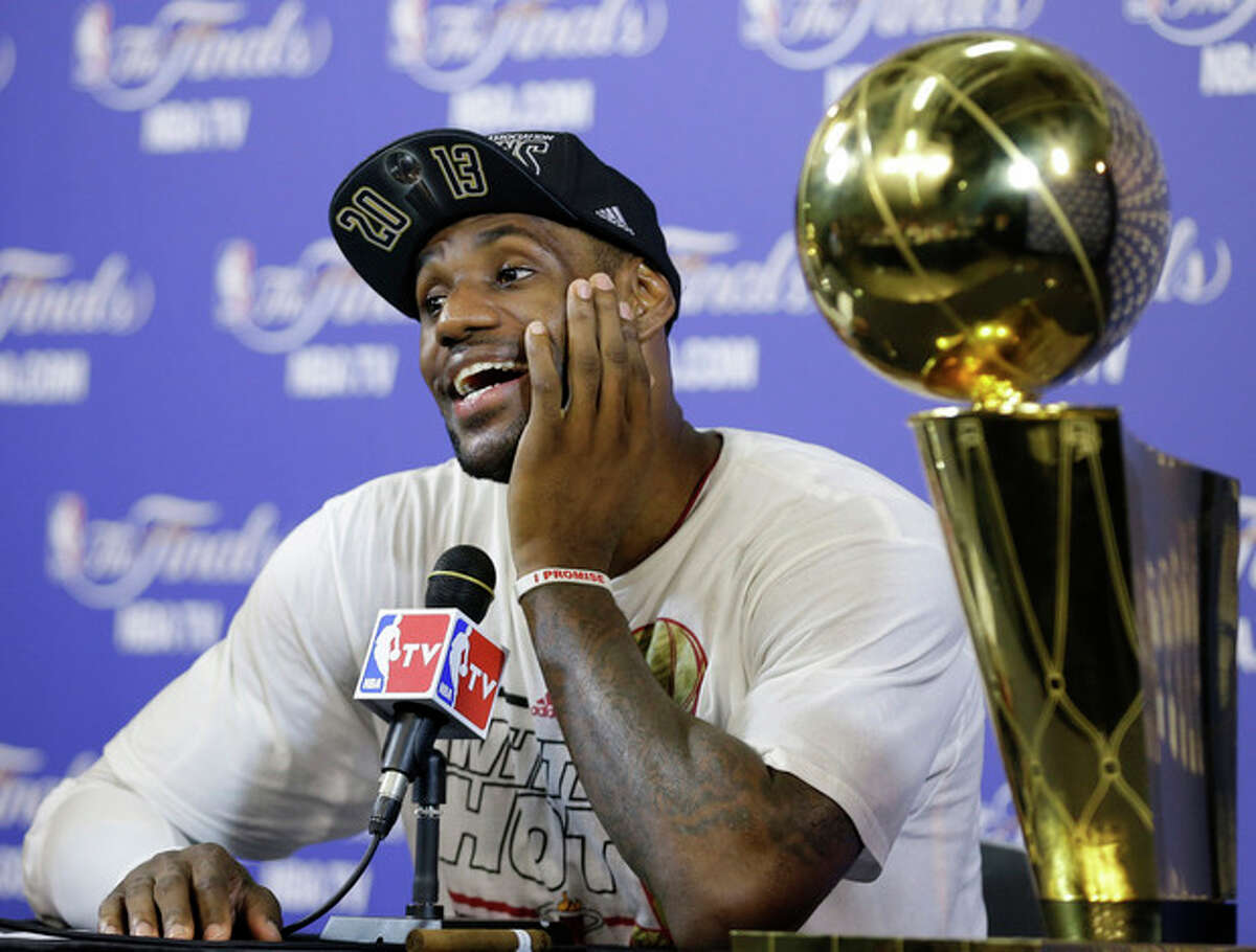 The Miami Heat's LeBron James smiles during a post game news conference following Game 7 of the NBA basketball championship game against the San Antonio Spurs, Friday, June 21, 2013, in Miami. The Miami Heat defeated the San Antonio Spurs 95-88 to win their second straight NBA championship. (AP Photo/Lynne Sladky)