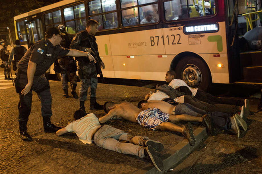 A group of protestors lie on the ground lay on the ground before being searched by police during an anti-government demonstration in Rio de Janeiro, Brazil, Thursday, June 20, 2013. More than half a million Brazilians poured into the streets of at least 80 Brazilian cities Thursday in demonstrations that saw violent clashes and renewed calls for an end to government corruption and demands for better public services. Riot police battled protesters in at least five cities, with some of the most intense clashes happening in Rio de Janeiro, where an estimated 300,000 demonstrators swarmed into the seaside city's central area.(AP Photo/Felipe Dana) / AP