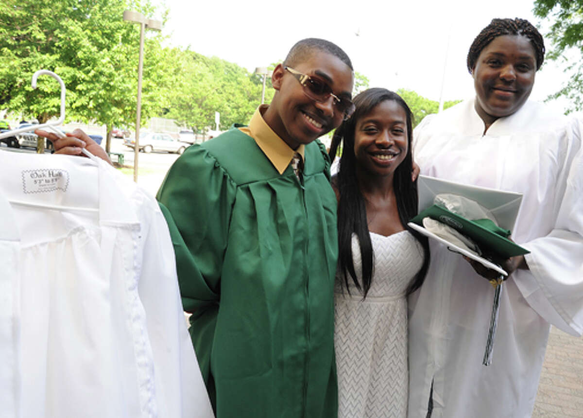 Michael Morris, Crystal Hilll and Jasmine Henry at the Norwalk High School graduation on Friday. Hour photo/Matthew Vinci