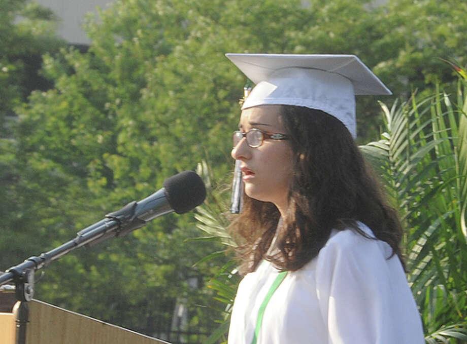 Megan O'Callaghan sings the Star Spangled Banner at the Norwalk High School graduation on Friday. Hour photo/Matthew Vinci