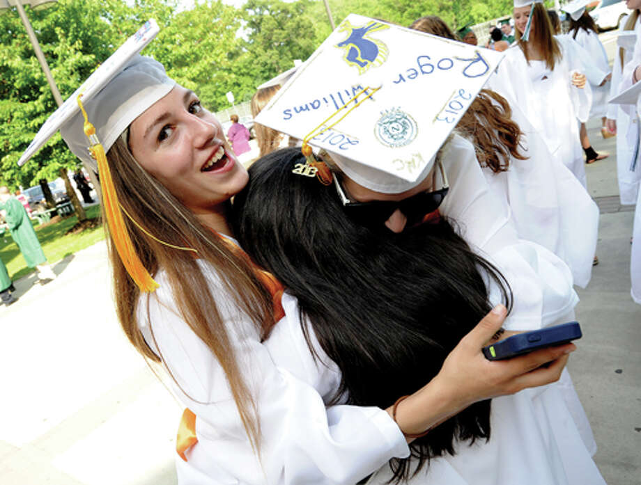Jamie Waring and Kate Cusick hugging at the Norwalk High School graduation on Friday. Hour photo/Matthew Vinci