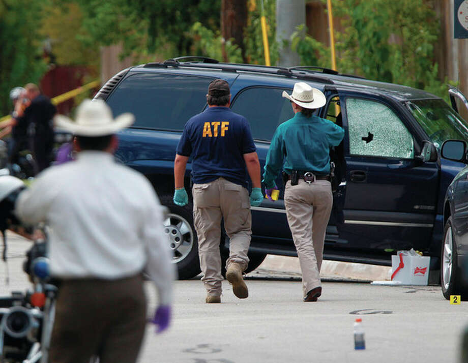 AP photo / Houston Chronicle, Mayra BeltranATF and other investigators walk near a vehicle which was struck by a bullet near the scene where a gunman opened fire near the Texas A&M university on Monday in College Station, Texas. / Houston Chronicle