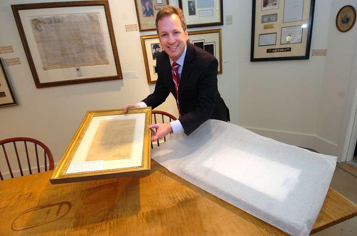 Hour Photo/ Alex von Kleydorff. Seth Kaller presents some very rare framed documents by George Washington at Rockwell Art gallery in Westport