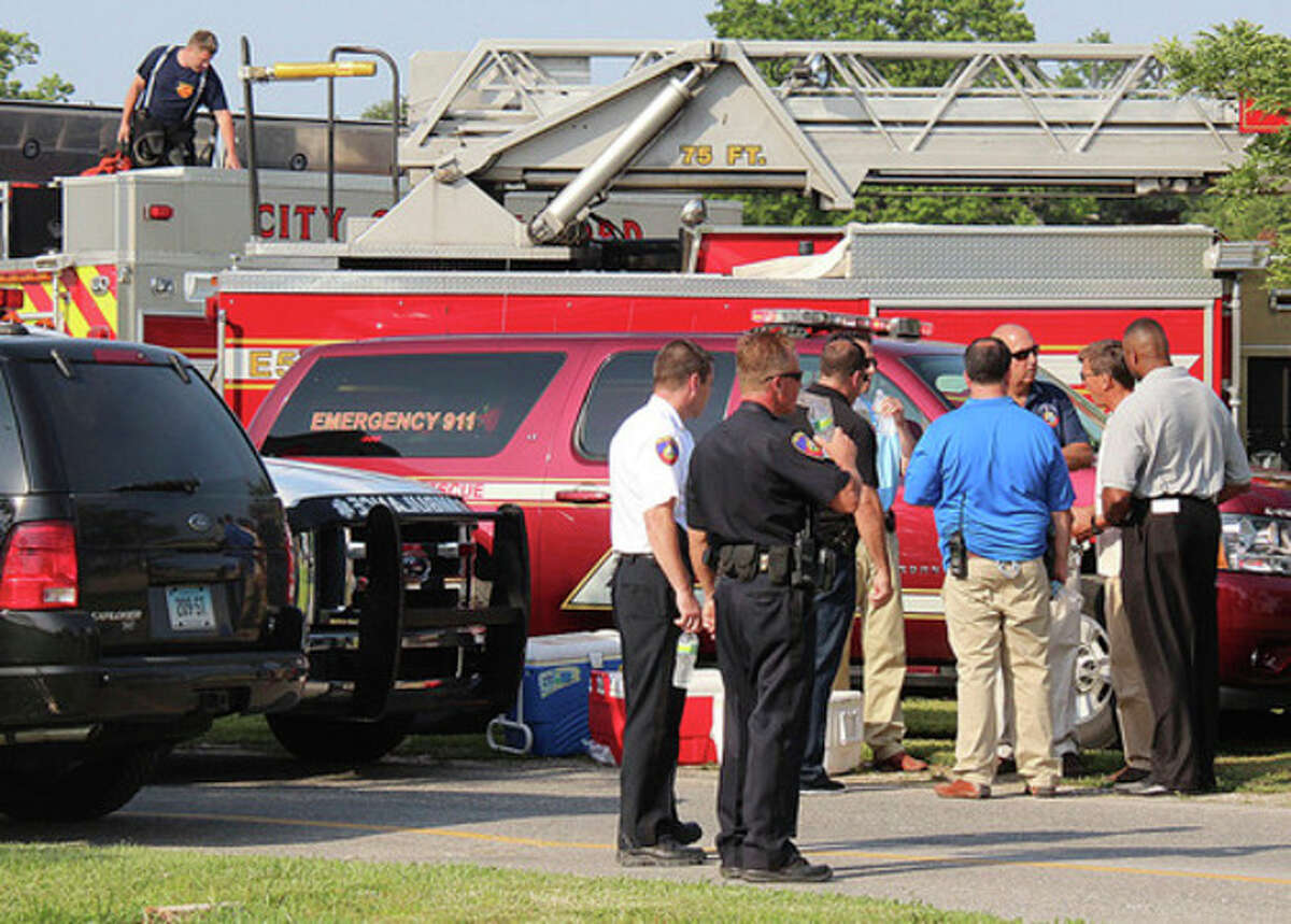 Hour photo by Chris Bosak Emergency personnel at Cove Island Park in Stamford looking for a boy who was struggling under water.