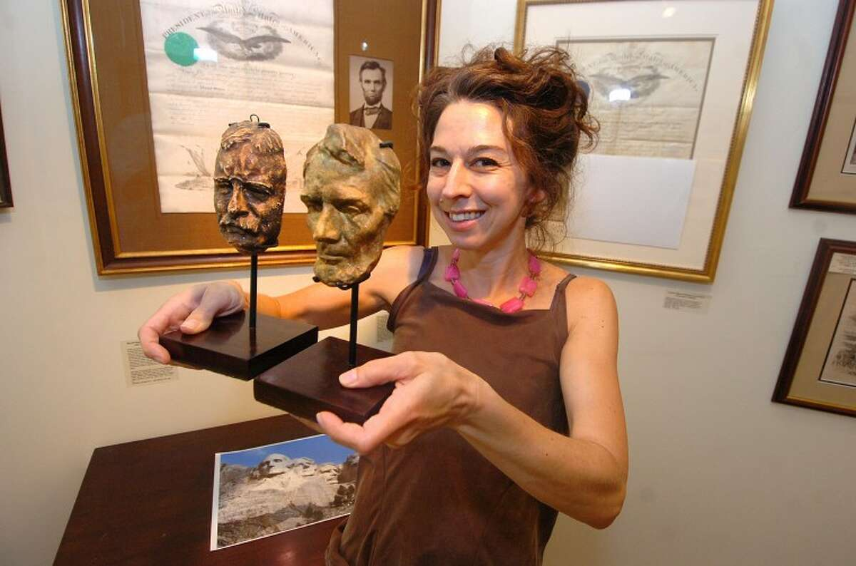 Hour Photo/ Alex von Kleydorff. Sooo-z Mastropietro Gallery Director holds sculpture studies made by Gutzon Borglum for the final project Mount Rushmore