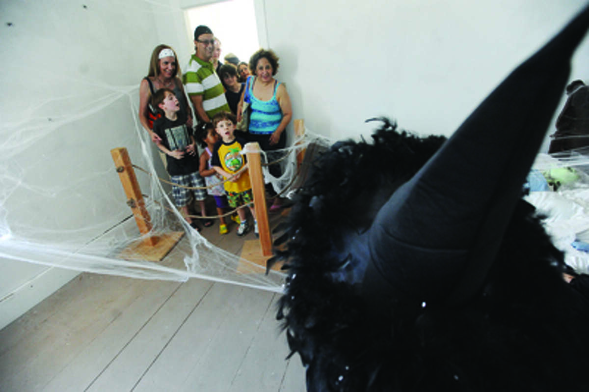Families enter the haunted lighthouse at Sheffield Islan on Sunday. hour photo/Matthew Vinci
